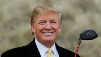 "U.S. property mogul Donald Trump holds a golf club during a media event on the sand dunes of the Menie estate, the site for Trump's proposed golf resort, near Aberdeen, Scotland, Britain May 27, 2010.    REUTERS/David Moir/File Photo                  FROM THE FILES PACKAGE ""THE CANDIDATES"" - SEARCH CANDIDATES FILES FOR ALL 90 IMAGES"
