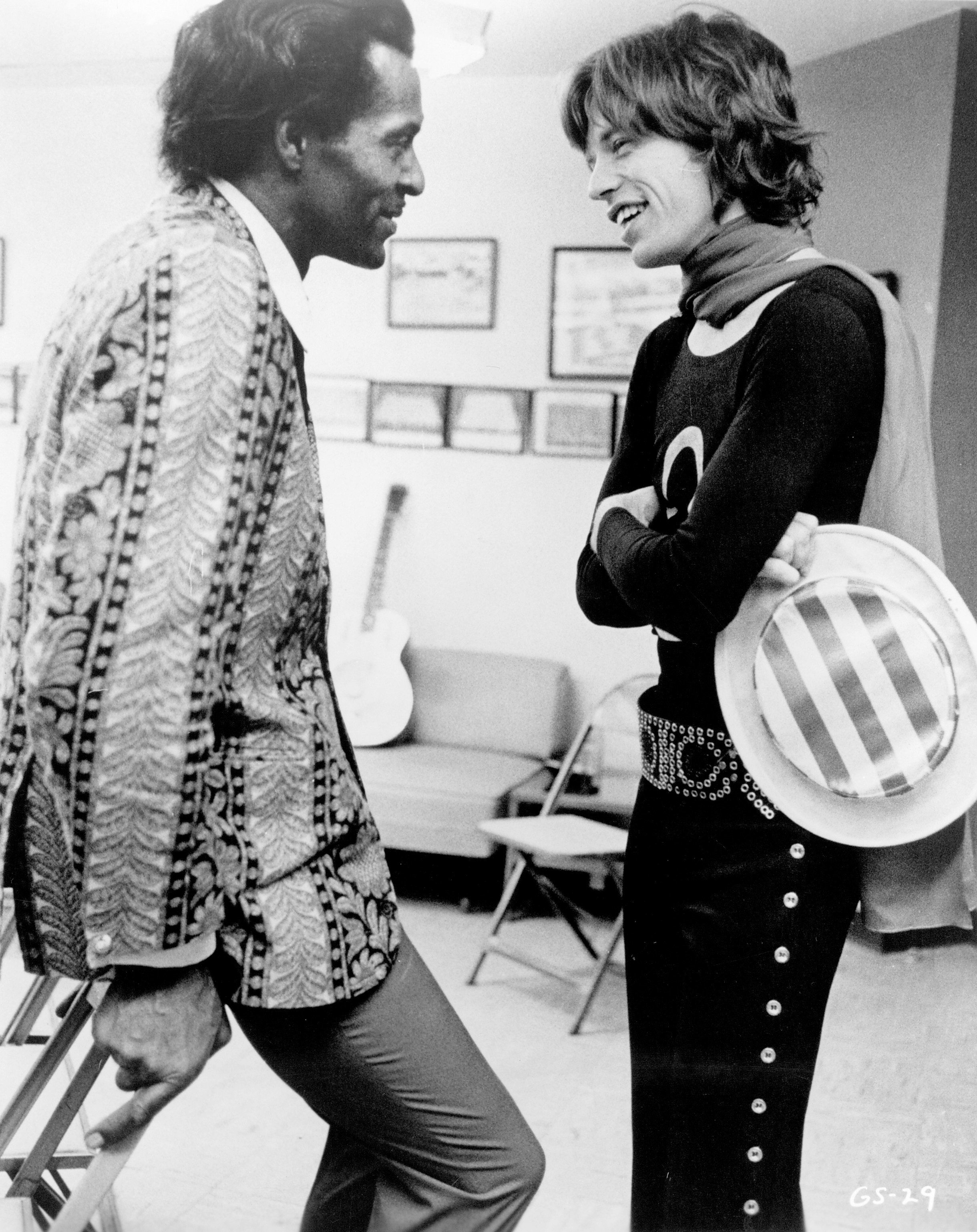 NEW YORK - NOVEMBER 28:  Mick Jagger of the rock and roll band 'The Rolling Stones'  chats backstage with Chuck Berry at Madison Square Garden in a concert that was recorded and later released as the live album 'Get Yer Ya-Ya's Out' and also as part of the film 'Gimme Shelter' on November 28, 1969 in New York City, New York. (Photo by Michael Ochs Archives/Getty Images)