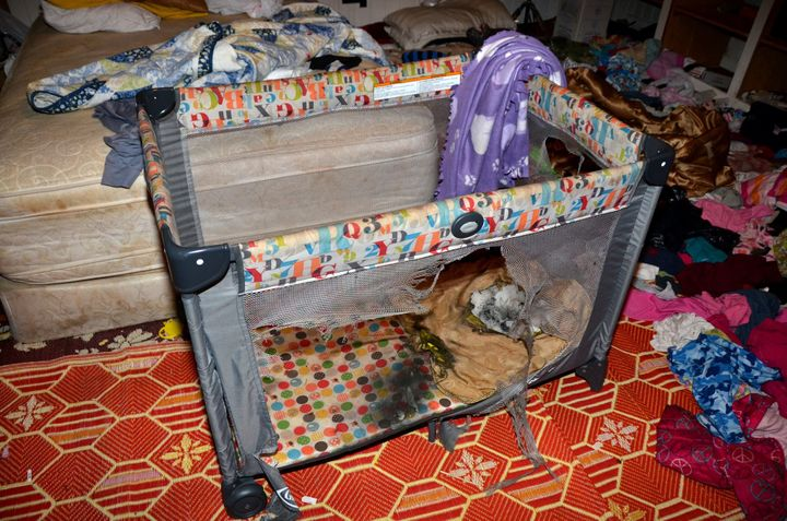 "<em>""The playpen where a flash-bang grenade landed during a raid in Cornelia, Ga. The heat singed away much of the pillo"