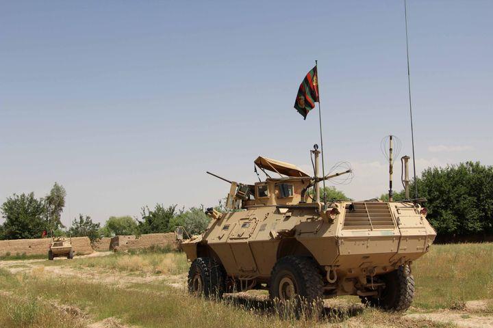 A military vehicle patrols in the Babaji area of Lashkar Gah Helmand province, Afghanistan May 8, 2016.