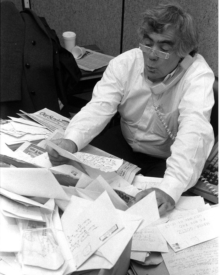 Jimmy Breslin in his office at the Daily News reading his mail