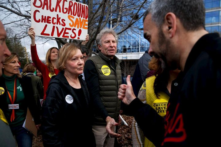 <strong>Author Andy Parker and his wife, Barbara, get a thumbs-up from an activist as they take part in a protest and vigil a
