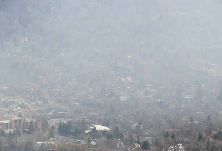 Smoke covers Boulder as a wildfire burns near Sunshine Canyon.