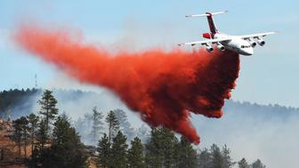 DENVER, CO - MARCH 19:  Fire crews fight a wildfire from the air in Sunshine Canyon on March 19, 2017 in Boulder, Colorado. More than 1,000 homes have been evacuated west of Boulder due to the fire. (Photo by RJ Sangosti/The Denver Post via Getty Images)