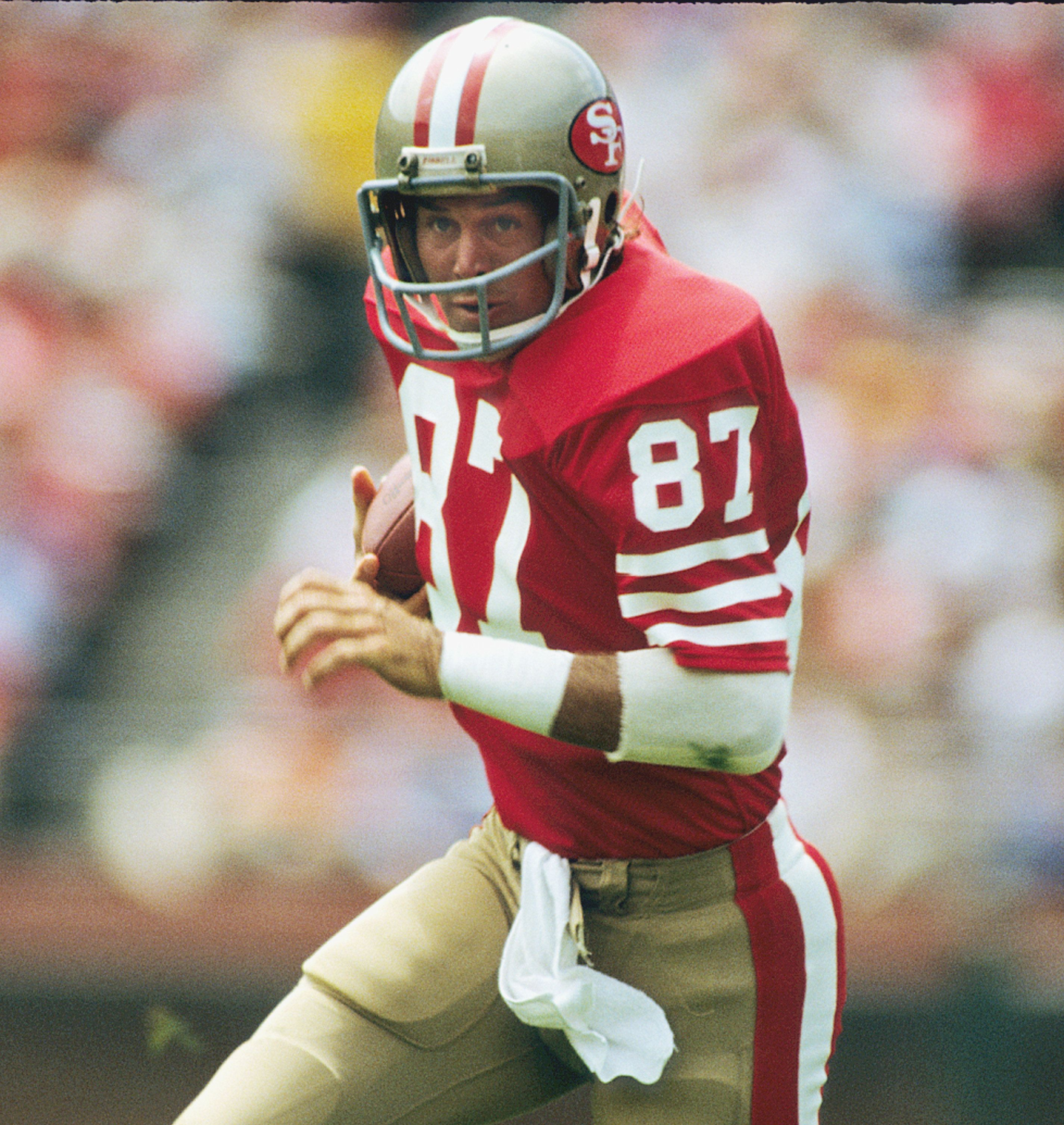 SAN FRANCISCO, CA - SEPTEMBER 12:  Dwight Clark #87 after catching a pass against the Los Angeles Raiders on September 12, 1982 in San Francisco, California.  (Photo by Ronald C. Modra/  Getty Images)