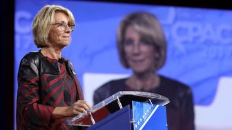 NATIONAL HARBOR, MD - FEBRUARY 23:  U.S. Secretary of Education Betsy DeVos addresses the Conservative Political Action Conference at the Gaylord National Resort and Convention Center February 23, 2017 in National Harbor, Maryland. Hosted by the American Conservative Union, CPAC is an annual gathering of right wing politicians, commentators and their supporters.  (Photo by Chip Somodevilla/Getty Images)
