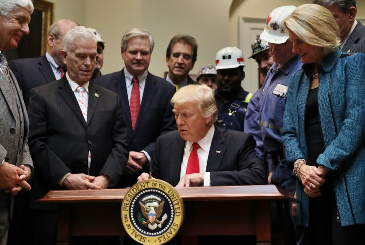 President Donald Trump signs a resolution tonullify the Stream Protection Ruleat the White House on Feb. 16, 2017