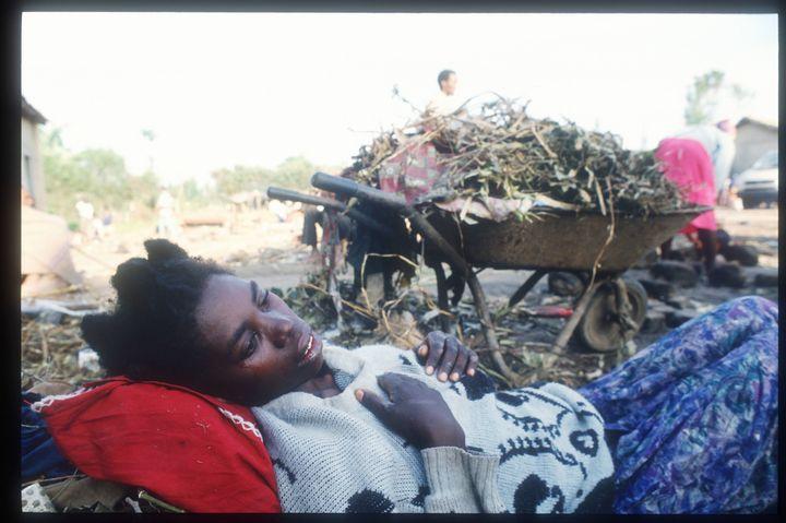 A Tutsi woman lies ill outside the Ruhango refugee camp May 25, 1994, in Rwanda.