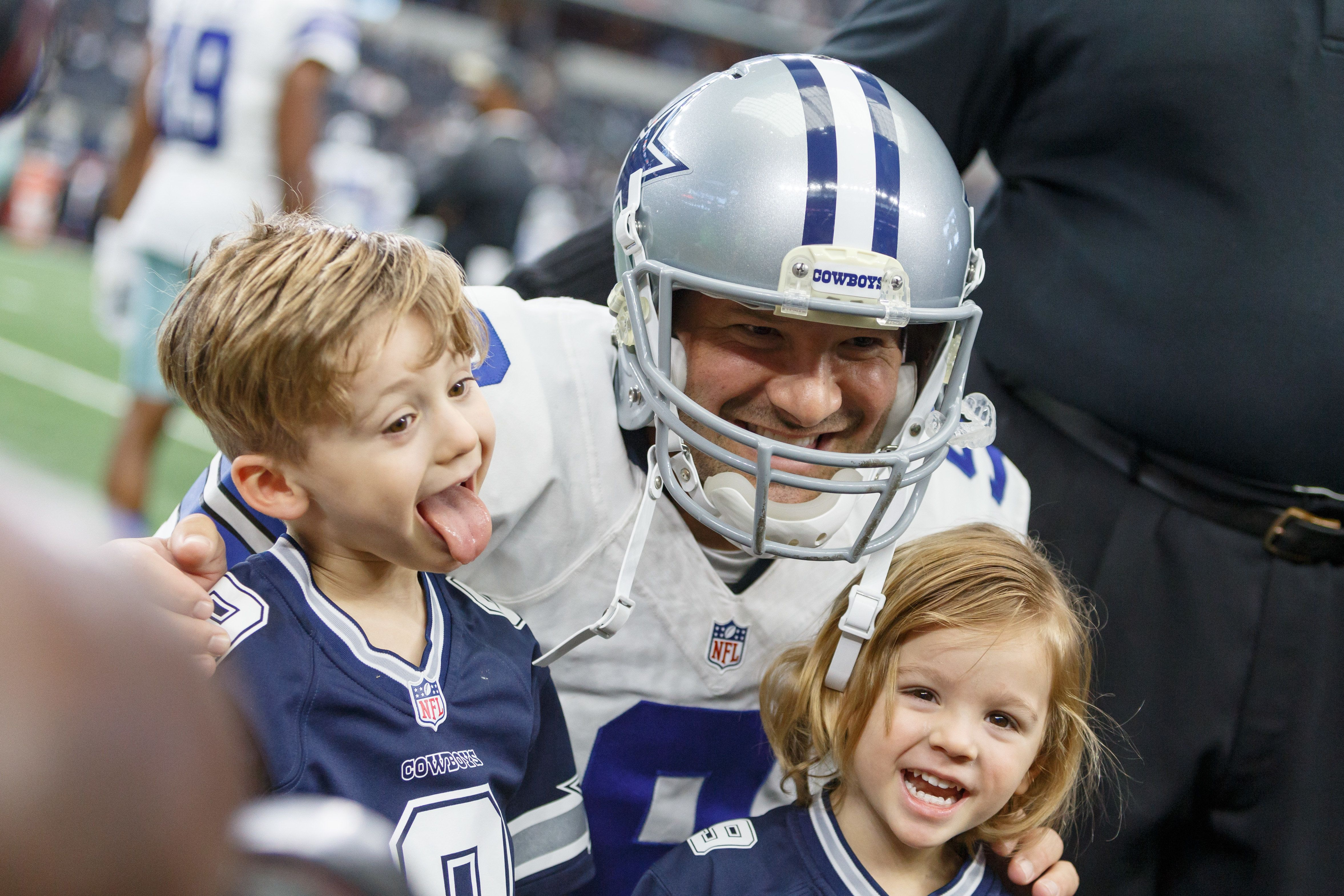 ARLINGTON, TX - NOVEMBER 20: Dallas Cowboys Quarterback Tony Romo (9) poses with his kids prior to the NFL game between the Baltimore Ravens and Dallas Cowboys on November 20, 2016, at AT&T Stadium in Arlington, TX.  (Photo by Andrew Dieb/Icon Sportswire via Getty Images)