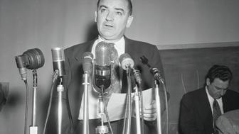 (Original Caption) McCarthy Answers the President. Washington: In answer to President Eisenhower's press conference remarks, Sen. Joseph McCarthy (R.Wisc.) is shown as he issued a statement at the Capitol in which he said, 'This silly tempest in a teapot arose because we dared to bring to light the cold, unpleasant facts about a fifth amendment Communist Army officer...'