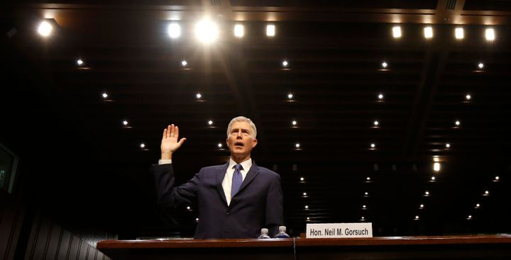 Supreme Court nominee Neil Gorsuch is sworn in to testify at his Senate Judiciary Committee confirmation hearing Monday.