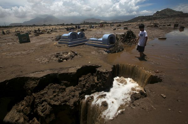 A view of a damaged cemetery after rainfall and flooding in Trujillo.