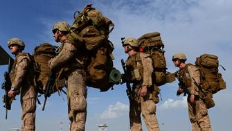 US Marines wait to board an aircraft in Kandahar Afghanistan