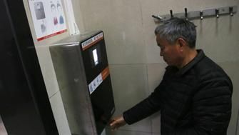 BEIJING, CHINA - MARCH 20:  The machine recognizes a man's face to give out toilet paper automatically at a toilet in the park of the Temple of Heaven on March 20, 2017 in Beijing, China. Six toilet roll machines which can recognize one's face to give out paper automatically have been installed at the park of the Temple of Heaven in Beijing. Each person can get 60cm to 70cm toilet paper every time, and can't get twice within 9 minutes.  (Photo by VCG/VCG via Getty Images)