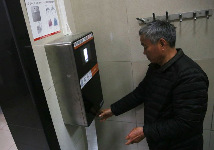 The machine recognizes a man's face to give out toilet paper automatically at a toilet in the park of the Temple of Heaven in