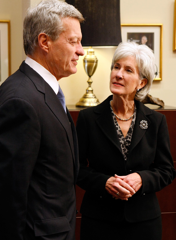 Then-Senate Finance Committee Chairman Max Baucus (D-Mont.) receivesthen-Health and Human Services Secretary-designate