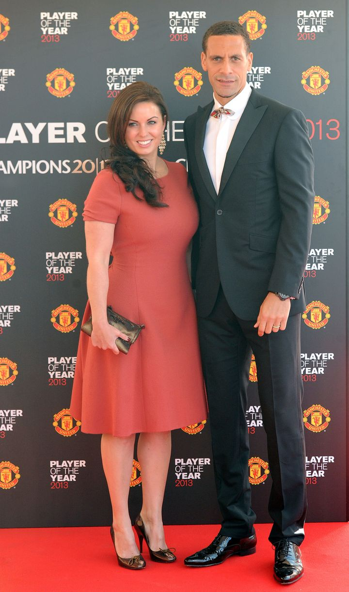 Manchester United's Rio Ferdinand with wife Rebecca Ellison arrive for the Manchester United Player of the Year Awards at Old Trafford, Manchester, May 2013.