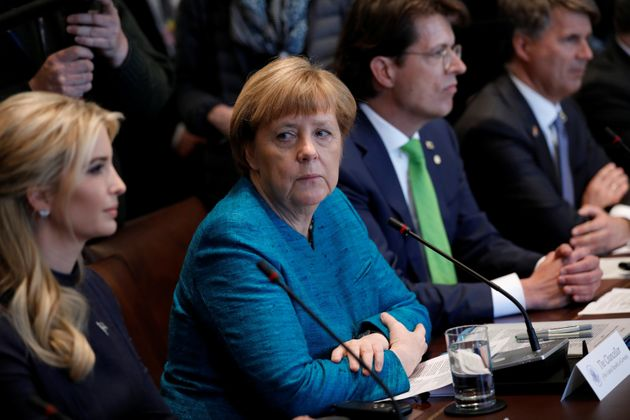 Ivanka Trump sits next to German chancellor Angela Merkel during her visit to the