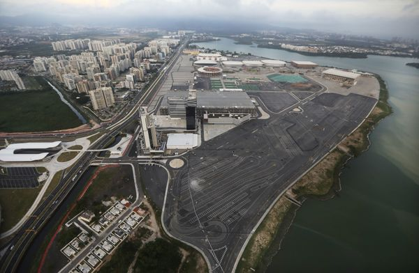The Olympic Park stands with polluted water along the shoreline.