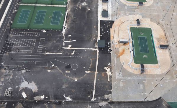 Remains of tennis facilities stand in Olympic Park.