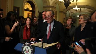 WASHINGTON, DC - MARCH 14:  Senate Minority Leader Charles Schumer (C) (D-NY) speaks as Sen. Amy Klobuchar (L) (D-MN), Sen. Mark Warner (2L) (D-VA), Sen. Tammy Baldwin (2R) (D-WI) and Sen. Elizabeth Warren (R) (D-MA) look on during a news conference on Capitol Hill on March 14, 2017 in Washington, DC. Republican and Democratic senators answered a range of questions following their weekly policy luncheon.  (Photo by Justin Sullivan/Getty Images)