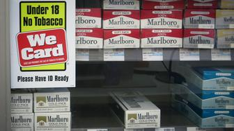 Shelves full of cigarettes are pictured at a CVS store in the Manhattan borough of New York February 5, 2014. CVS Caremark Corp said on Wednesday that it would stop selling tobacco products at its 7,600 stores by October, becoming the first national drugstore chain in the United States to take cigarettes off the shelves. Public health experts called the decision by the No. 2 U.S. drugstore chain a precedent-setting step that could pressure other retailers to follow suit. It comes at a time when pharmacies are taking on a much bigger role in healthcare. REUTERS/Carlo Allegri (UNITED STATES - Tags: BUSINESS HEALTH)