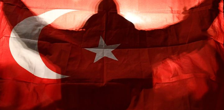 A demonstrator holds a Turkish flag outside the Turkish consulate in Rotterdam in March 2017.