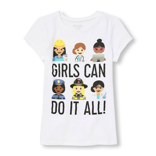 "The ""Girls Can Do It All"" emoji shirt shows a female police officer, doctor, construction worker and scientist."