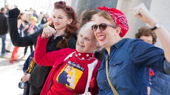 UNITED STATES - MARCH 22: Sylvia Tanis, a Rosie the Riveter during World War II, poses with guests at the WWII Memorial, March 22, 2016. Tanis was part of an Honor Flight from Detroit who were on a tour of D.C. that included stops on Capitol Hill, the Memorial, and Arlington National Cemetery. (Photo By Tom Williams/CQ Roll Call)