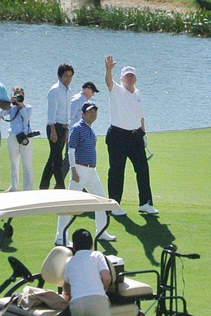 President Donald Trump withJapan's Prime Minister Shinzo Abe golfing at the president's Trump National Doralcours