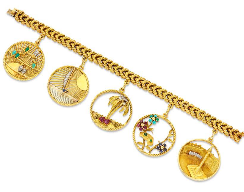 Simon Teakle's Van Cleef & Arpels'  <em>18K gold and gem set charm bracelet with link bracelet suspending five large circular