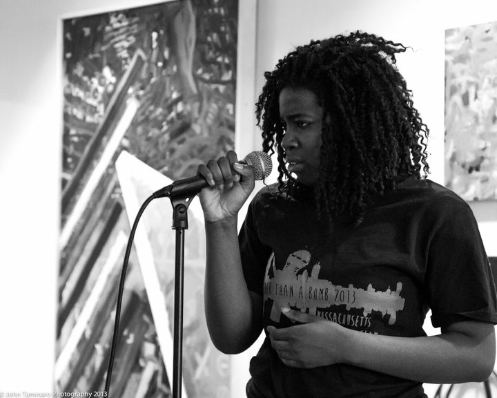 A student performs at the 2013 Louder Than a Bomb slam poetry competition in Boston, Massachusetts.