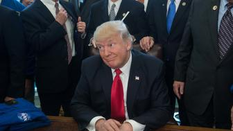 US President Donald Trump looks on after signing a bill increasing funding for NASA in the Oval Office at the White House in Washington, DC, on March 21, 2017. / AFP PHOTO / NICHOLAS KAMM        (Photo credit should read NICHOLAS KAMM/AFP/Getty Images)