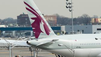 The tail section of a Qatar Airways jet can be seen on a parked jet on March 21, 2017 at John F. Kennedy International Airport in New York.  Passengers traveling to the United States from 10 airports in eight Muslim-majority countries will be prohibited from bringing laptops, tablets and other portable electronic devices on board with them when they fly. The nine airlines affected by the US ban are Royal Jordanian, EgyptAir, Turkish Airlines, Saudi Arabian Airlines, Kuwait Airways, Royal Air Maroc, Qatar Airways, Emirates and Etihad Airways. / AFP PHOTO / DON EMMERT        (Photo credit should read DON EMMERT/AFP/Getty Images)