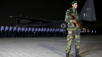 A soldier stands guard as Air Force officers await the casket of Pakistan Air Force (PAF) flying officer Marium Mukhtiar during a funeral at the PAF Base Faisal in Karachi, Pakistan November 24, 2015. Mukhtiar was killed on Tuesday when her trainer jet crashed near the central town of Mianwali, the military said, the first such loss for the country's tiny community of women pilots. REUTERS/Akhtar Soomro