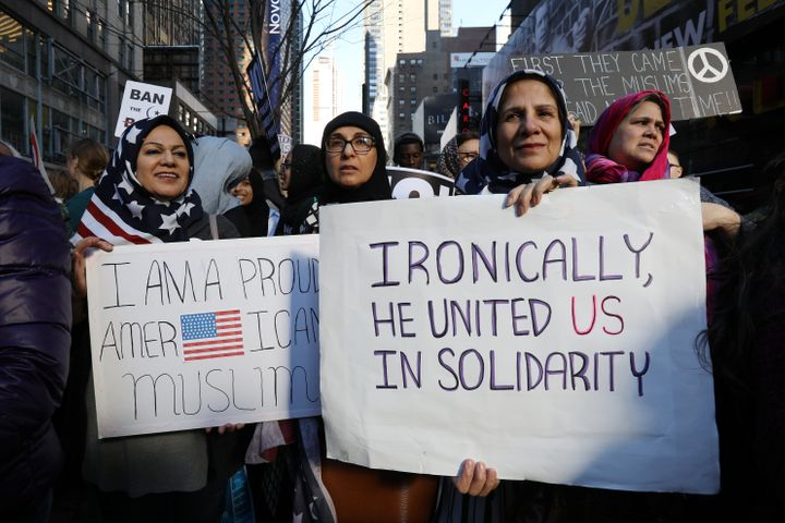 "Women wearing U.S. flag hijabs gather at an ""I Am Muslim Too"" rally in New York City last month."