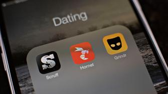 Gay dating apps Scruff, Hornet, and Grindr are displayed for a photograph on an Apple Inc. iPhone in Tiskilwa, Illinois, U.S., on Tuesday, Jan. 20, 2015. For gay men flocking to smartphone dating applications, making a connection increasingly comes with messages about HIV status, testing and drug regimens. Some apps let users declare their status, remind them to get tested and give locations of the closest clinics. Photographer: Daniel Acker/Bloomberg via Getty Images