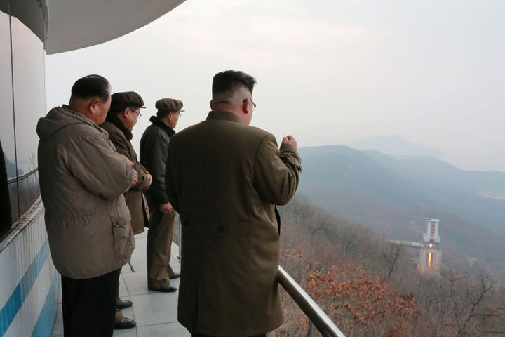 North Korean leader Kim Jong Un, right, watches a ground jet test. Earlier this month, Pyongyang launched four ballistic miss