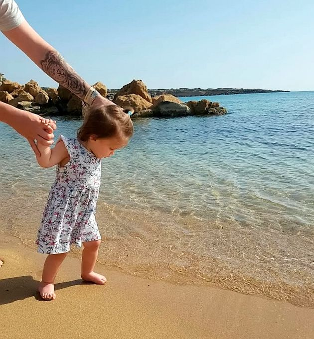 Harper walking in the sea during the