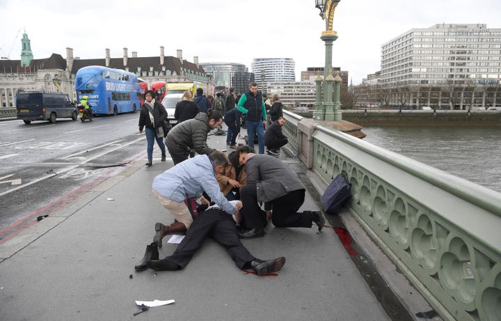 People rushed to treat the injured after the attack on Westminster Bridge.