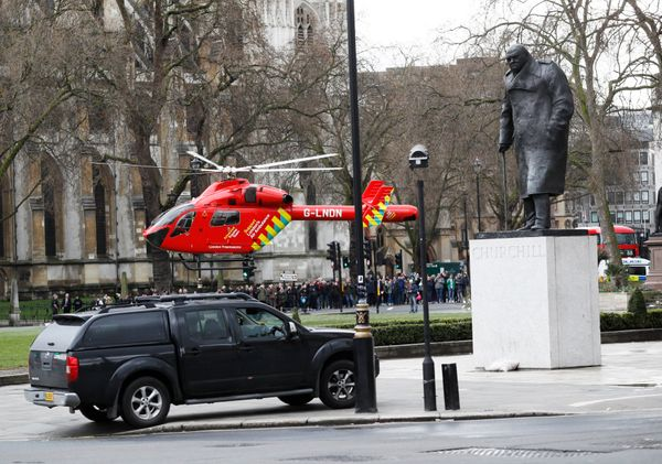An air ambulance lands in Parliament Square.