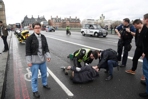 Injured people are assisted after an incident on Westminster Bridge in London on March 22, 2017.