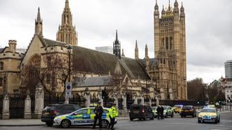 LONDON, ENGLAND - MARCH 22: Armed police officer stand guard near Westminster Bridge and the Houses of Parliament on March 22, 2017 in London, England. A police officer has been stabbed near to the British Parliament and the alleged assailant shot by armed police. Scotland Yard report they have been called to an incident on Westminster Bridge where several people have been injured by a car. (Photo by Jack Taylor/Getty Images)