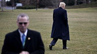 A member of the Secret Service stands watch as U.S. President Donald Trump walks toward Marine One on the South Lawn of the White House in Washington, D.C., U.S., on Friday, Feb. 3, 2017. Trump today signed two directives aimed at staring the process of rolling back the regulatory system put in place after the financial crisis. Among the targets are rules that protect against predatory lenders, force brokers to lower fees for retirees and ban proprietary trading. Photographer: Andrew Harrer/Bloomberg via Getty Images