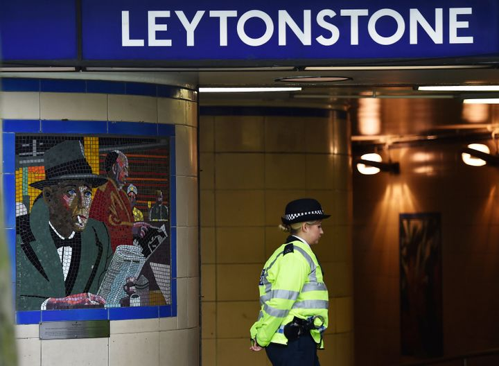 A police officer stands on duty outside Leytonstone Underground station in east London, Dec. 7, 2015.