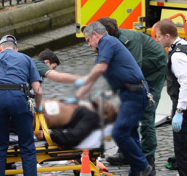 The suspected attacker receiving treatment at the Houses of