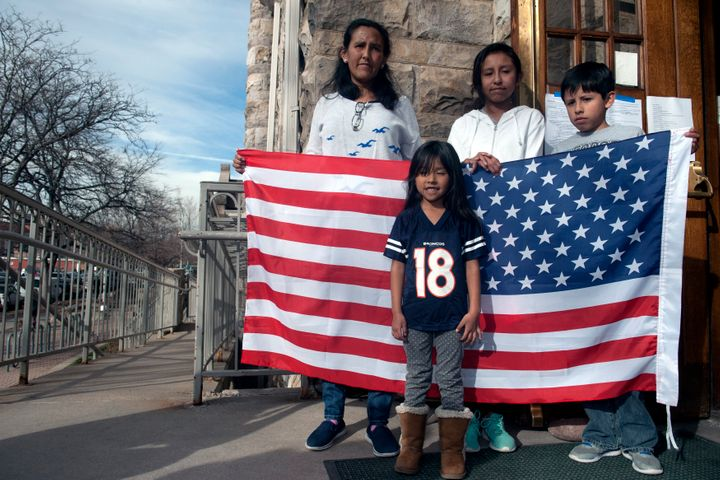 Jeanette Vizguerra and her three U.S.-born children stand outside the First Unitarian Church in Denver, where she took refuge