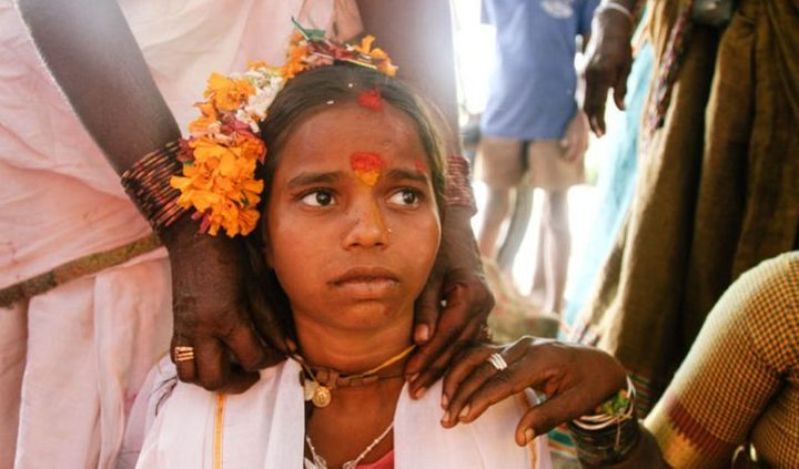 A young girl being married off to a temple deity