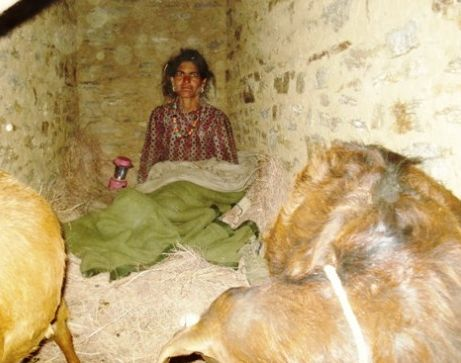 A woman living inside a stone cowshed for the entire duration of her menstrual cycle.
