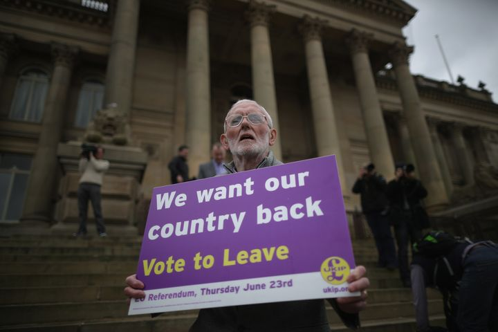 A campaigner holds a placard calling for the U.K. to leave the European Union.